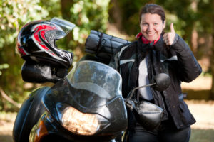 GettyImages 171147980 300x200 Woman posing happily next to her motorcycle
