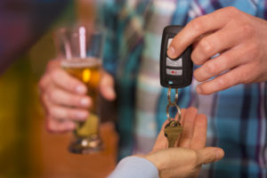 Spot a Drunk Driver 1 300x200 Drinking and Driving.  Man gives car keys to friend.  Beer.